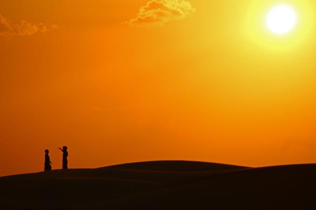couple at dusk camel safari